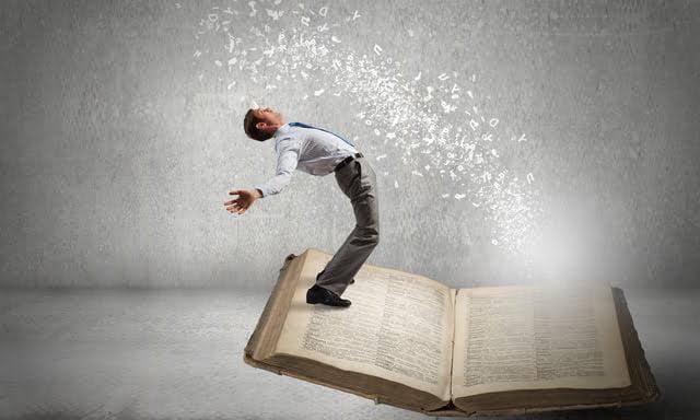 本から飛び出したキャラクターを避ける男性